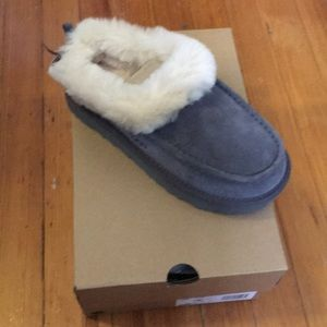 New with tags. Never worn Ugg Slippers for women